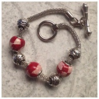 3 checkered memorial charms, 3 metal charms and bracelet