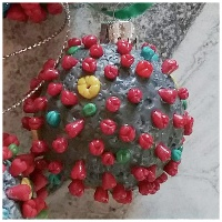 coronavirus model made into a christmas tree ornament for covid 19 this year 2020
